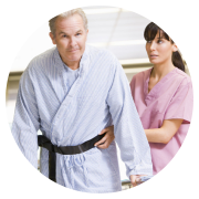 nurse with male patient in rehabilitation