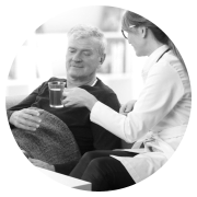 elderly man sitting together with his caregiver